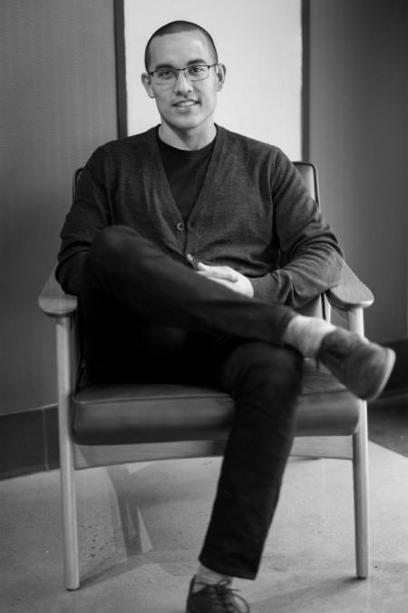 Latin American author Marcos Antonio Hernandez sitting down